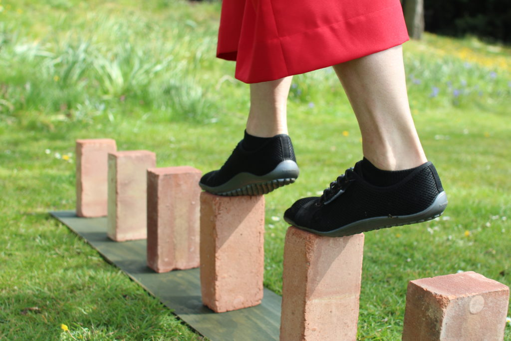 StrongLady walking on bricks